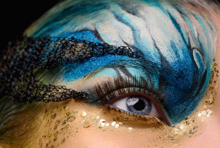 Young woman eye with fantasy make up